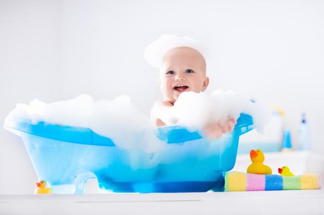Little baby taking a bath